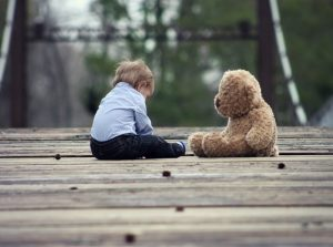 toddler and teddybear