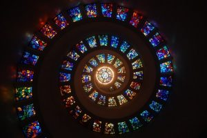 spiral of stained glass windows on a ceiling